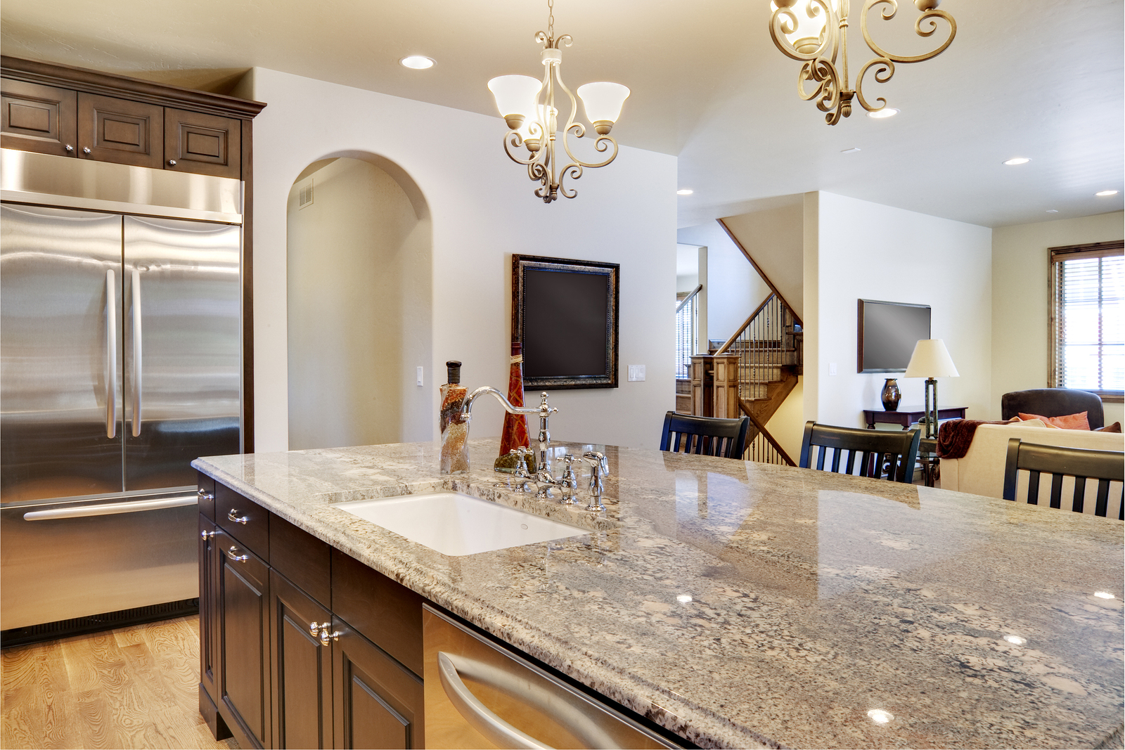 Kitchen with view looking over center island into great room