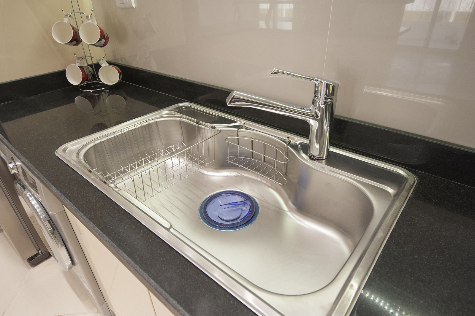 Interior design decor of kitchen in luxury apartment with sink and faucet