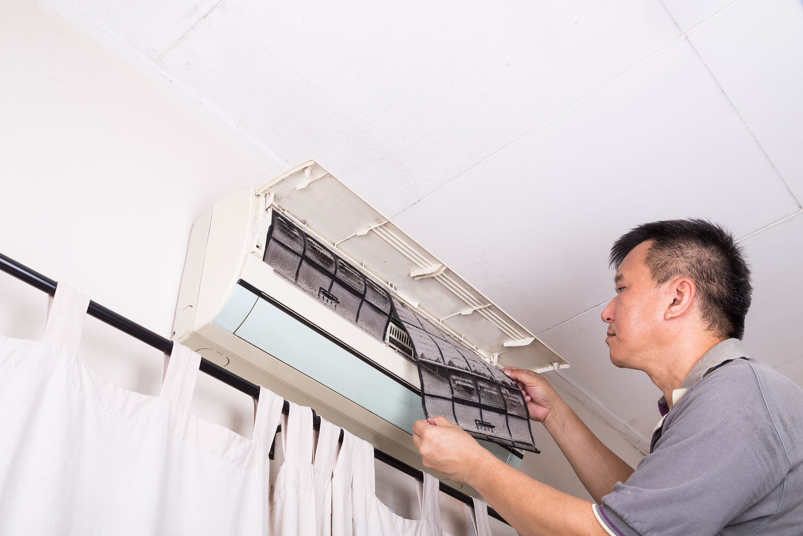 Technician servicing the indoor air-conditioning unit