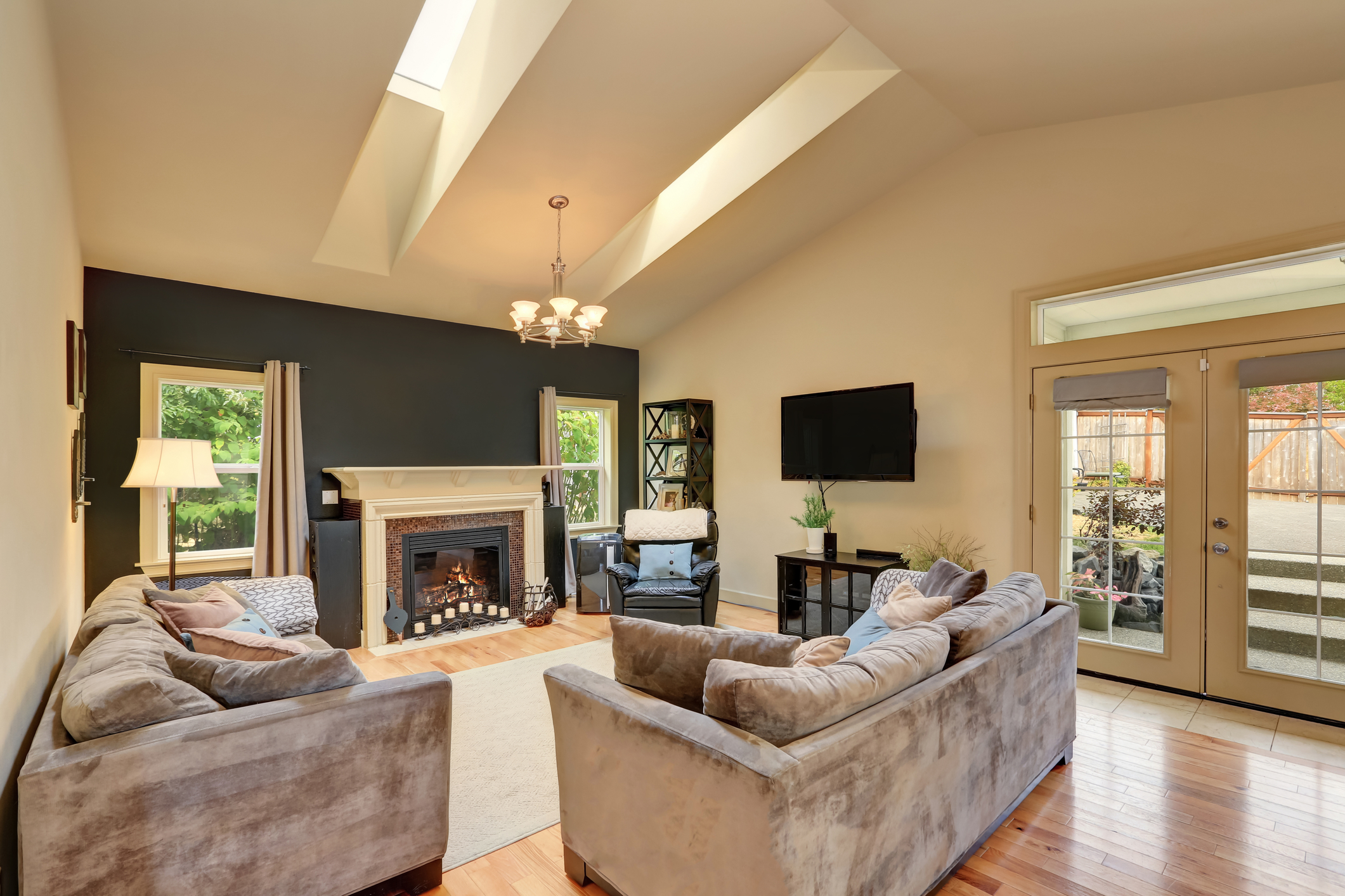 Classic American family room with fireplace and sofas