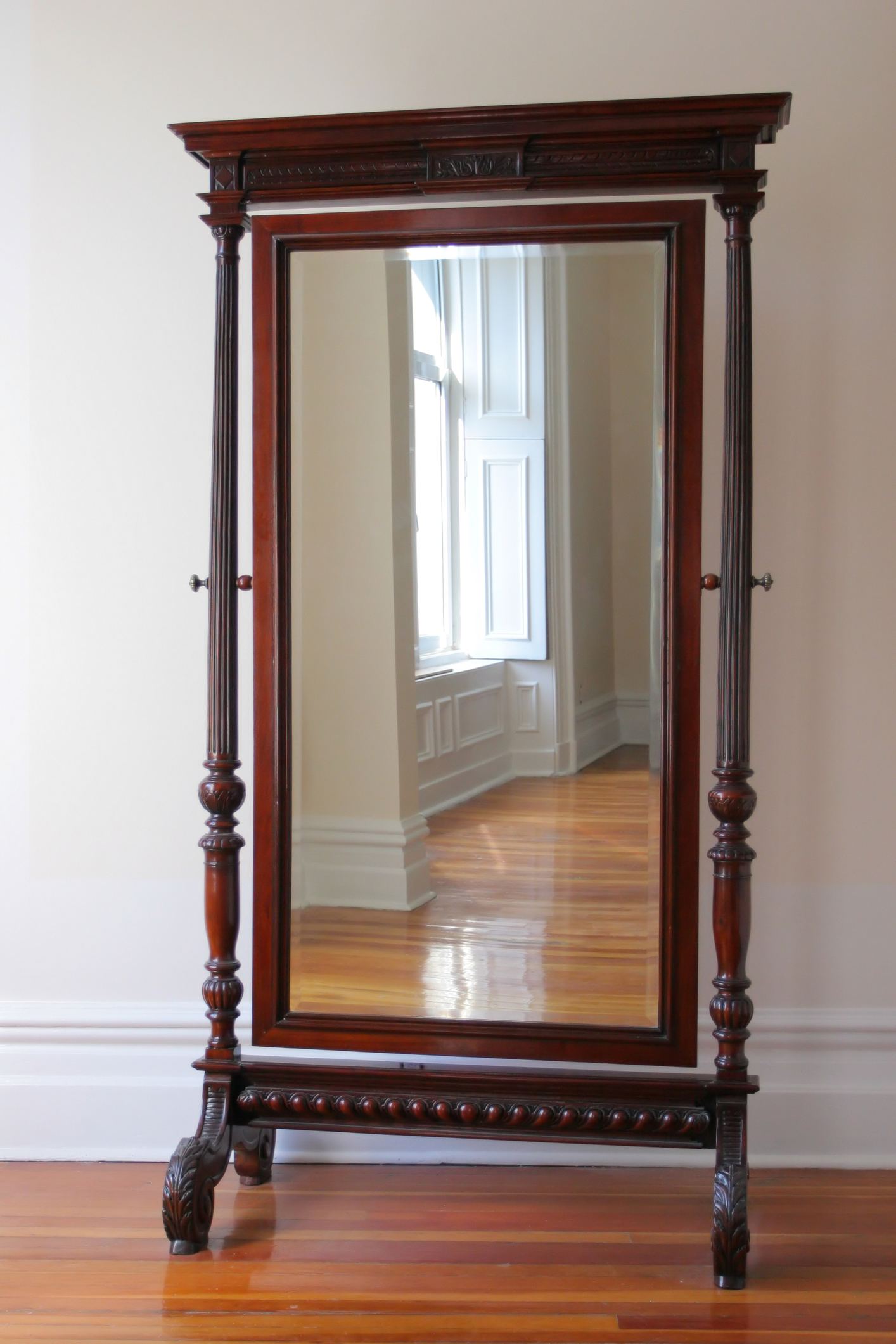Big antique mirror in a wooden frame on legs