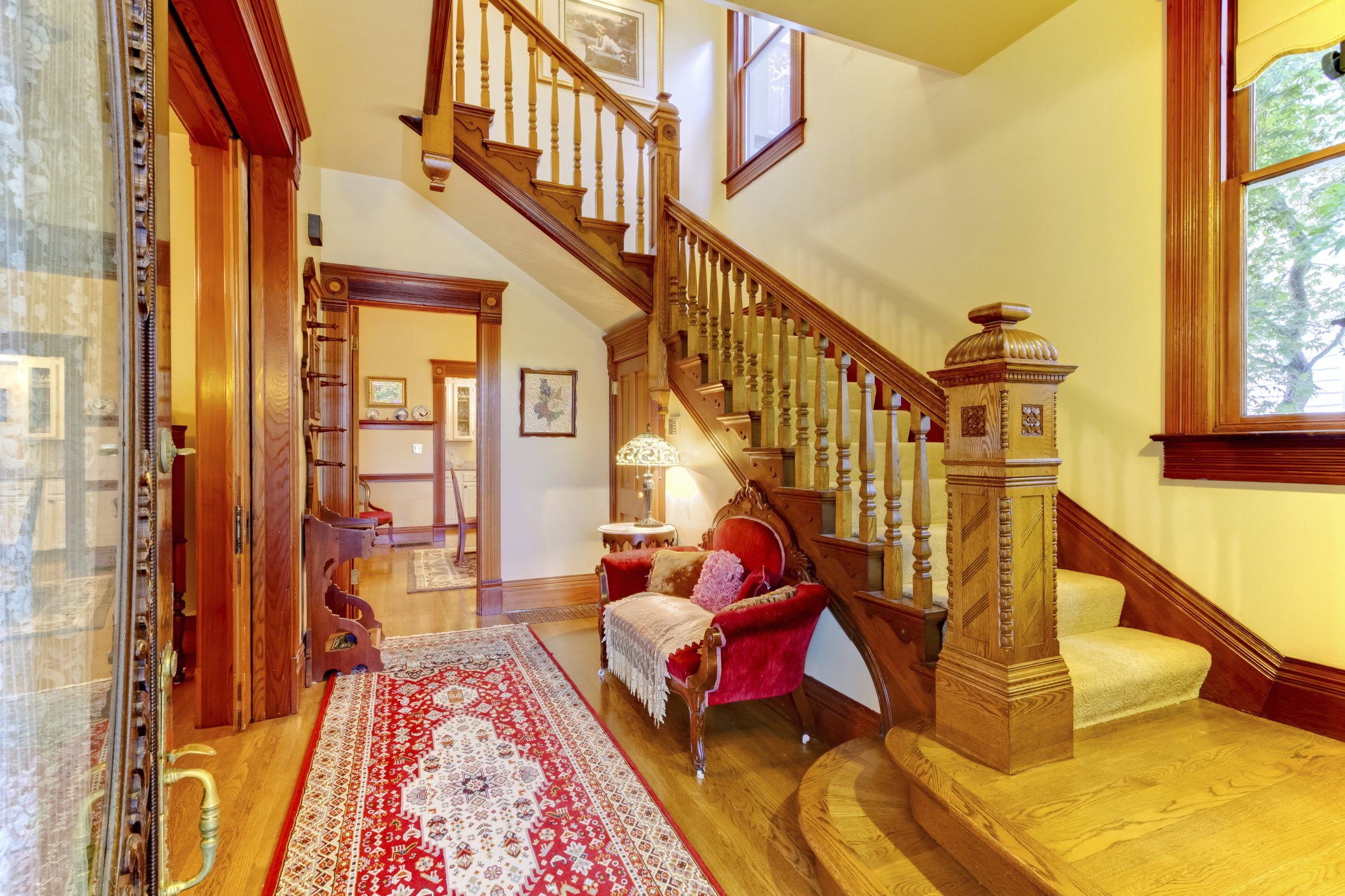 Bright hallway with colourful rug